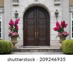wooden double doors with flower ... | Shutterstock . vector #209246935