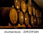 wine barrels stacked in the old ... | Shutterstock . vector #209259184