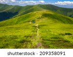 small lake near mountain curve path on a Green Hill - stock photo