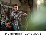 young man working in a biking... | Shutterstock . vector #209360071