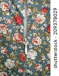zipper on flowers pattern cloth | Shutterstock . vector #209378029