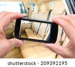 hands taking photo  car... | Shutterstock . vector #209392195