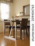 an image of dining room   Shutterstock . vector #209404765