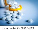 pills spilling out of pill...   Shutterstock . vector #209534521