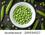 Green Peas In Bowl On Wooden...