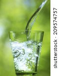 water pouring into glass   Shutterstock . vector #209574757