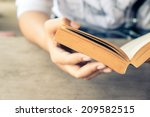closeup woman hand  holding...   Shutterstock . vector #209582515