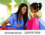 woman shopping with bags at the ... | Shutterstock . vector #209597509
