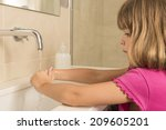 Closeup Of Child Washing Hands...