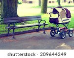 pram in the park with a bench | Shutterstock . vector #209644249