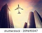 plane over big city | Shutterstock . vector #209690347