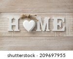 home sweet home  wooden text on ... | Shutterstock . vector #209697955