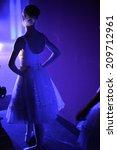 Dancer Standing Backstage...