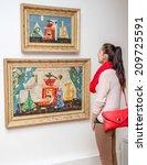 Small photo of RUZOMBEROK, SLOVAKIA - JULY 22: Girl looking at Fulla's painting in Gallery of Ludovit Fulla on July 22, 2014 in Ruzomberok