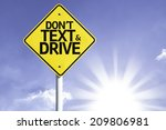 don't text and drive road sign... | Shutterstock . vector #209806981