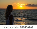 woman enjoying sunset at sea ... | Shutterstock . vector #209856769