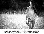 attractive female relaxing in... | Shutterstock . vector #209861065