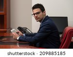 portrait of a young business... | Shutterstock . vector #209885185