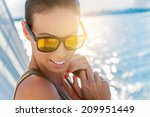 beautiful woman on a yacht at... | Shutterstock . vector #209951449