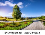 Flower Garden And Road In The...