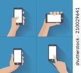hand holding black smartphone ... | Shutterstock .eps vector #210029641