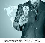 business man touching light of... | Shutterstock . vector #210061987