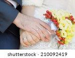 bride and groom's hands with... | Shutterstock . vector #210092419