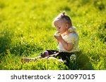 A Sweet Little Girl Sitting...