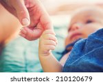 cute newborn baby holding... | Shutterstock . vector #210120679