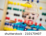 cute pupil using abacus in... | Shutterstock . vector #210170407