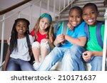cute pupils smiling at camera... | Shutterstock . vector #210171637