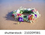 circlet of flowers on a sandy... | Shutterstock . vector #210209581