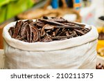 carob pods on sale in the market | Shutterstock . vector #210211375