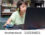 Little Boy Playing Pc Game At...