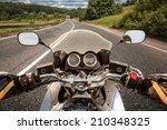 Biker Driving A Motorcycle...