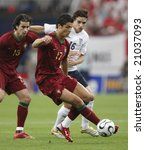 Gelsenkirchen, Germany July 1, 2006  Portugal's Cristiano Ronaldo in action against England during a World Cup round of 16 match. Editorial use only.  No pushing to mobile device usage. - stock photo