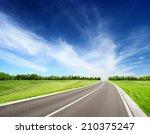 asphalt road between grassy...   Shutterstock . vector #210375247