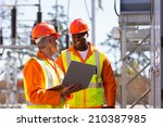 happy electricians using laptop ... | Shutterstock . vector #210387985