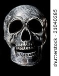 human skull on a black background - stock photo