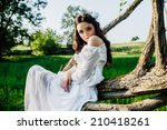 girl sitting on a tree | Shutterstock . vector #210418261