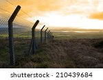 Barbed Wire Fencing Protecting...