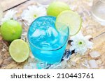 glass of blue cocktail with...   Shutterstock . vector #210443761