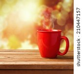 Red Coffee Cup Over Autumn...