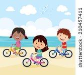 Kids Cycling On The Beach. Kid...