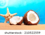 chopped coconut on sea beach... | Shutterstock . vector #210522559