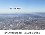 Airplane Flying Over The City