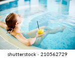 woman enjoying in swimming pool ... | Shutterstock . vector #210562729