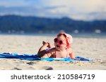 Stock photo cute little baby girl on tropical sand beach 210584719