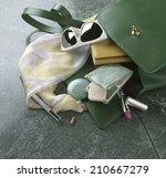 contents spilling from a handbag | Shutterstock . vector #210667279