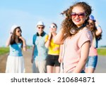 young woman with headphones on... | Shutterstock . vector #210684871